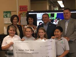 3rd Grade Students Raise $1,200 for Kenner Food Bank